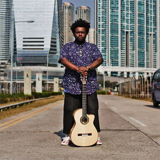 James Fauntleroy In The Street With Guitar