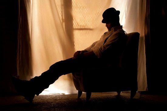 lil-john-roberts-hat-sitting-in-chair