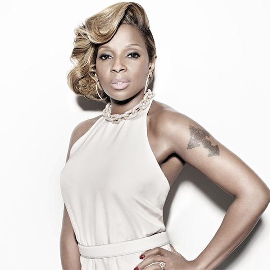 Mary J Blige With Hand On Hip In Tan Dress