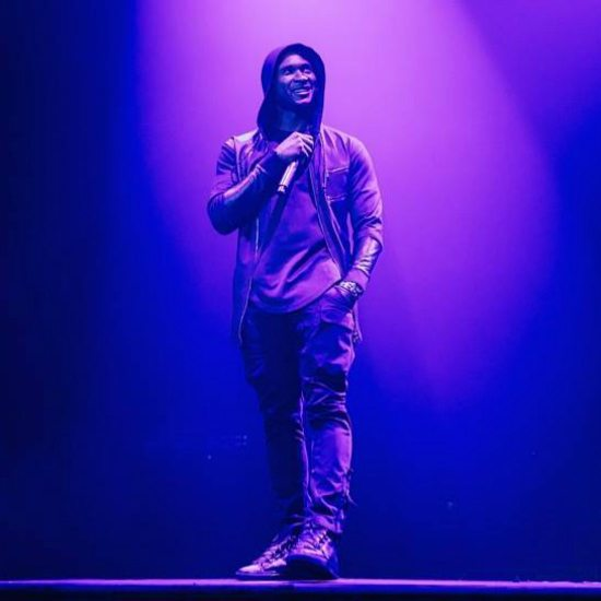 usher-on-stage-purple-blue-lighting