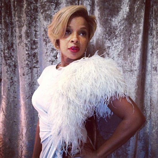 Mary J Blige In White In Front Of SIlver Curtain