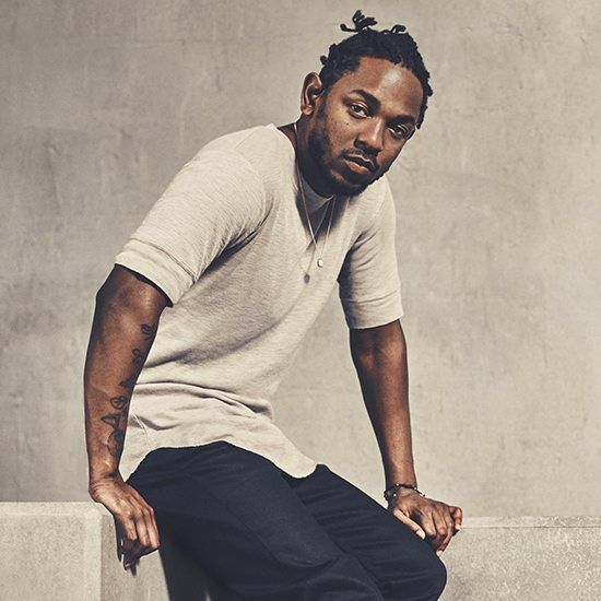 Kendrick Lamar Sitting In Tan Shirt With Black Pants