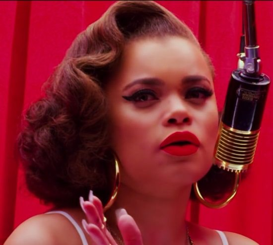 andra-day-forever-mine-video-still-red-velvet-curtain-red-matte-lipstick-winged-eyeliner-gold-hoops-gold-microphone
