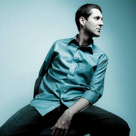 nicolay-blue-shirt-seated