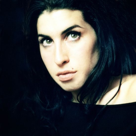 Amy-Winehouse-With-Hair-Down-In-Front-Of-Black-Background