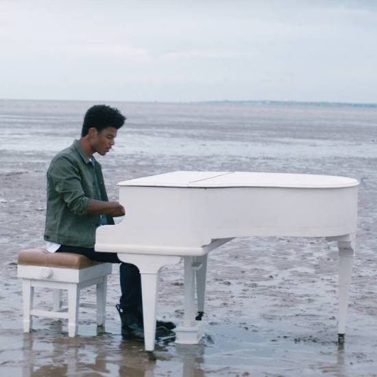kyan-sometimes-music-video-still-white-grand-piano-beach