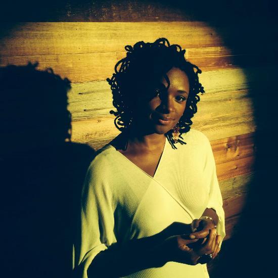 lizz-wright-lean-in-music-video-still-white-dress-circle-spotlight-shadow