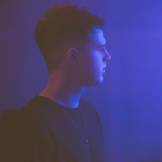 louis-mattrs-profile-black-shirt-blue-background