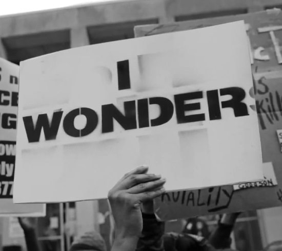louis-york-nerds-lyric-video-still-protest-sign