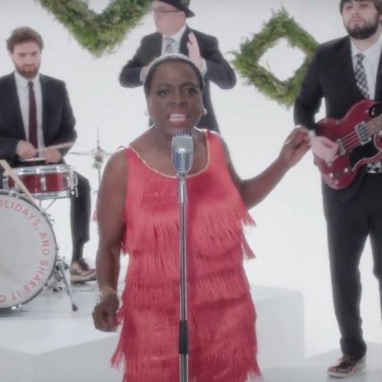 sharon-jones-the-dap-kings-white-christmas-music-video-still-red-fringe-dress-