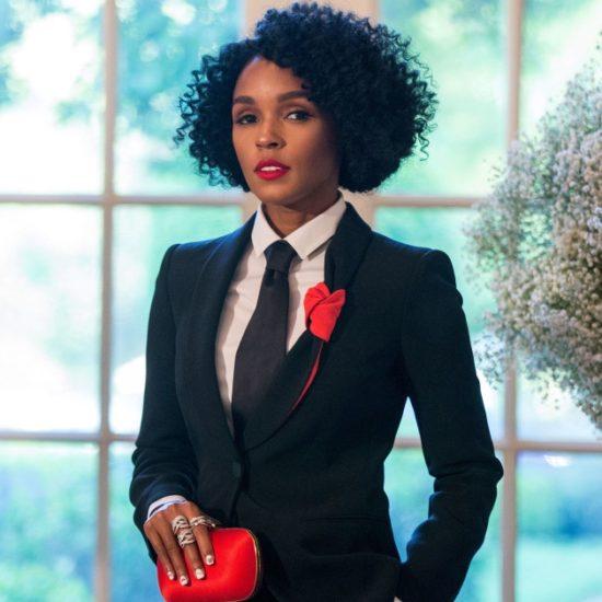 Janelle-Monae-Black-Suit-Red-Purse
