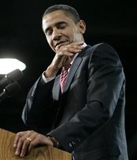 ObamaBrushingthatDirtOffHisShoulder.jpg